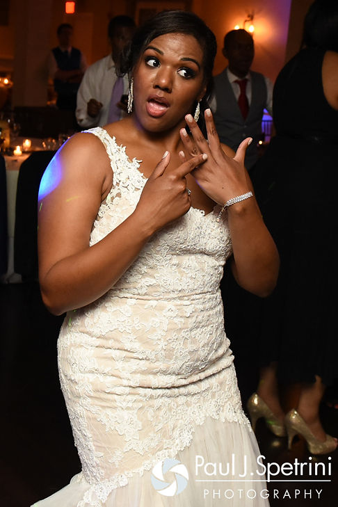 Kemi shows off her wedding ring during her and Warren's August 2016 wedding reception at the Villa at Riddler Country Club in East Bridgewater, Massachusetts.