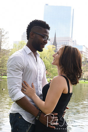 Courtnie and Richie pose for a photo in the Boston Public Gardens during their May 2018 engagement session in Boston, Massachusetts.