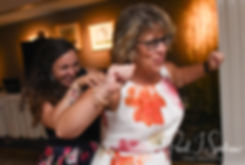 Laura dances with a guest during her June 2018 wedding reception at Independence Harbor in Assonet, Massachusetts.