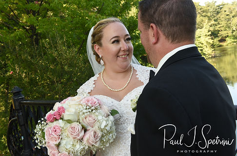 Courtney and Patrick pose for a photo at Roger Williams Park in Providence, Rhode Island following their September 2018 wedding at St. Paul Church in Cranston, Rhode Island.