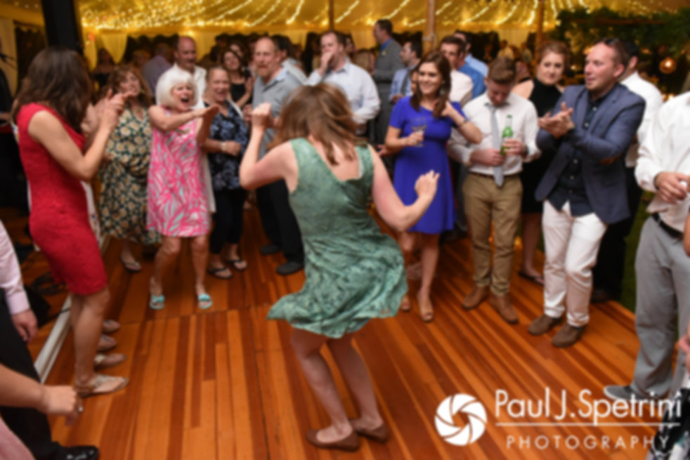 Guests dance during Molly and Tim's June 2017 wedding reception at Farmhouse-By-The-Sea in Matunuck, Rhode Island.