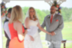 Michelle and Eric listen to a reading during their May 2016 wedding at Hillside Country Club in Rehoboth, Massachusetts.