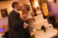 Nicole & Kurt kiss after cutting their wedding cake during their November 2018 wedding reception at the Publick House Historic Inn in Sturbridge, Massachusetts.