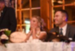 Nicole and Kurt react to a slideshow during their November 2018 wedding reception at the Publick House Historic Inn in Sturbridge, Massachusetts.