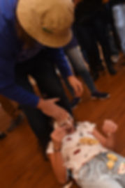 Amanda and Josh smash a cupcake in their niece's face during their October 2018 wedding reception at Loon Pond Lodge in Lakeville, Massachusetts.