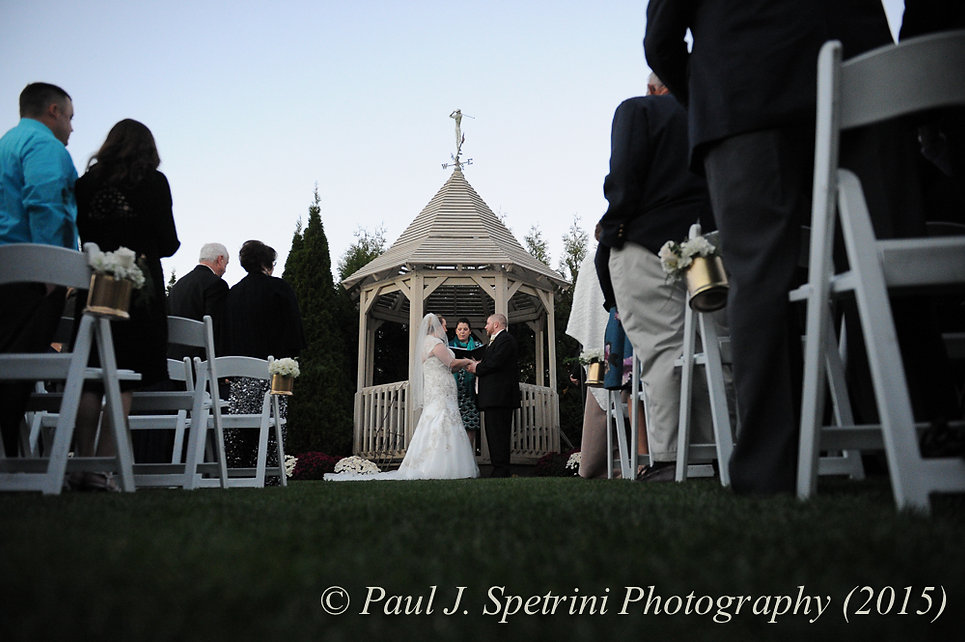 Kerry and Adam exchange their vows at their fall wedding at Quidnessett Country Club in North Kingstown, Rhode Island on October 23rd, 2015.