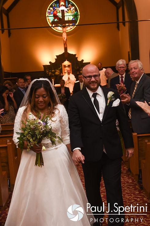 Forrester and Lisajean walk down the aisle following their October 2016 wedding ceremony at St. Thomas More Church in Narragansett, Rhode Island.