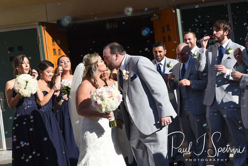 Sarah and Anthony kiss following their October 2018 wedding ceremony at St. Augustine Catholic Church in Providence, Rhode island.