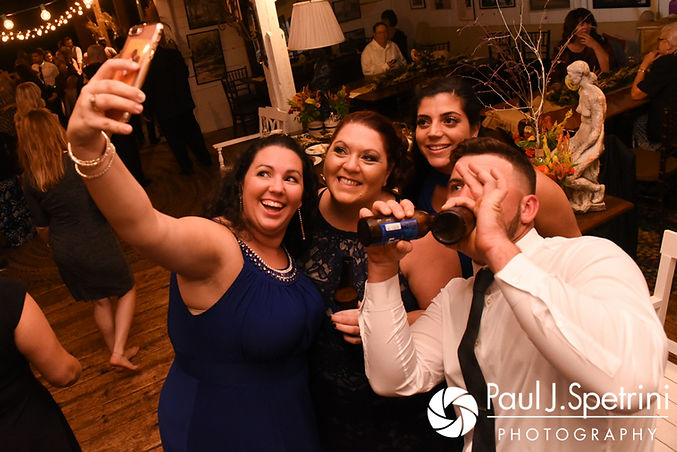 Guests pose for a photo during Samantha and Dale's October 2017 wedding reception at the Golden Lamb Buttery in Brooklyn, Connecticut.