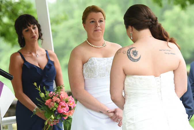 Marijke looks at Laura during her June 2018 wedding ceremony at Independence Harbor in Assonet, Massachusetts.