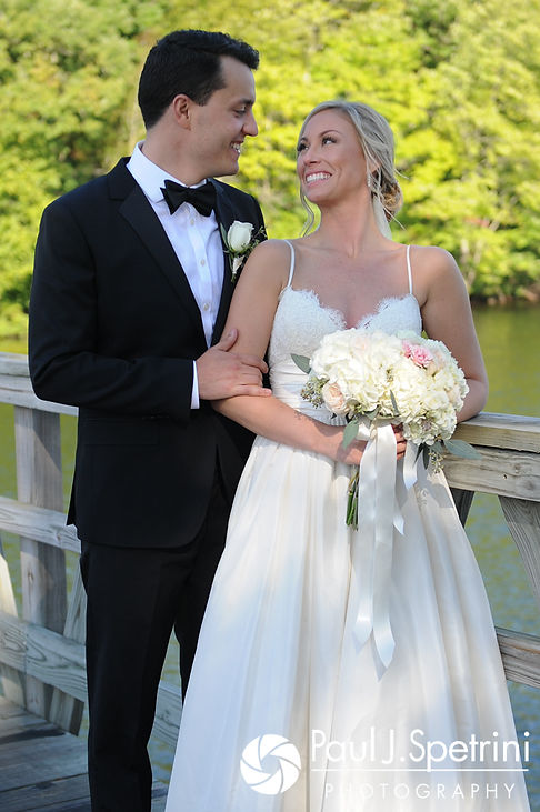 Laura and Laki pose for a formal photo prior to their September 2017 wedding ceremony at Lake of Isles Golf Club in North Stonington, Connecticut.