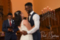 Courtnie and Richardson embrace during their August 2018 wedding ceremony at Glad Tidings Church in Quincy, Massachusetts.