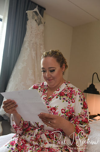 Courtney reads a letter from Patrick prior to her September 2018 wedding ceremony at St. Paul Church in Cranston, Rhode Island.