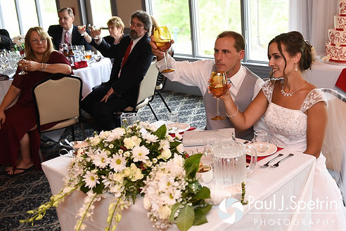 Heather and John raise their glasses for a toast during their July 2016 wedding reception at Crystal Lake Golf Club in Burrillville, Rhode Island.