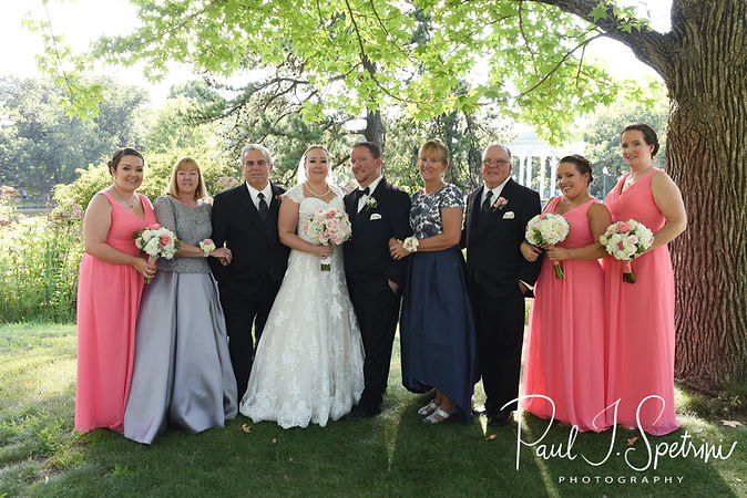 Courtney and Patrick pose for a photo with family members at Roger Williams Park in Providence, Rhode Island following their September 2018 wedding at St. Paul Church in Cranston, Rhode Island.