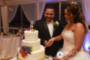 Stephanie and Henry cut the cake during their October 2016 wedding reception at Lake Pearl Luciano's in Wrentham, Massachusetts.