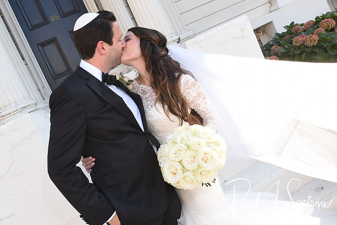 Helen and Mike pose for a photo following their September 2018 wedding ceremony at the Touro Synagogue in Newport, Rhode Island.