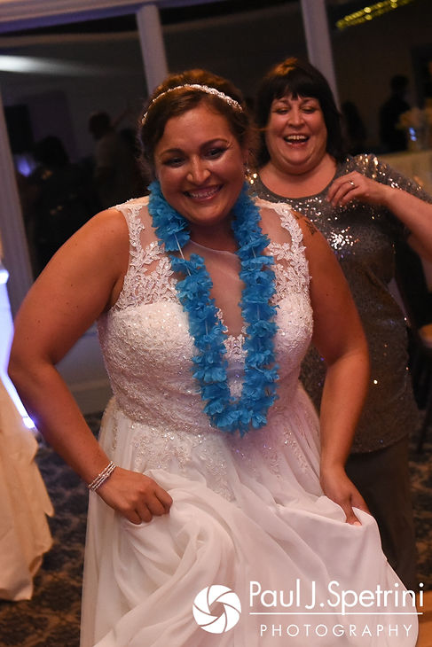 Toni laughs during her August 2017 wedding reception at Crystal Lake Golf Club in Mapleville, Rhode Island.