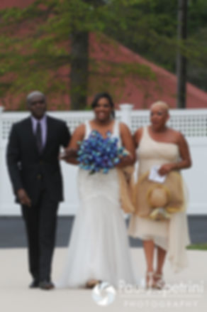 Kemi walks down the aisle during her August 2016 wedding reception at the Villa at Riddler Country Club in East Bridgewater, Massachusetts.