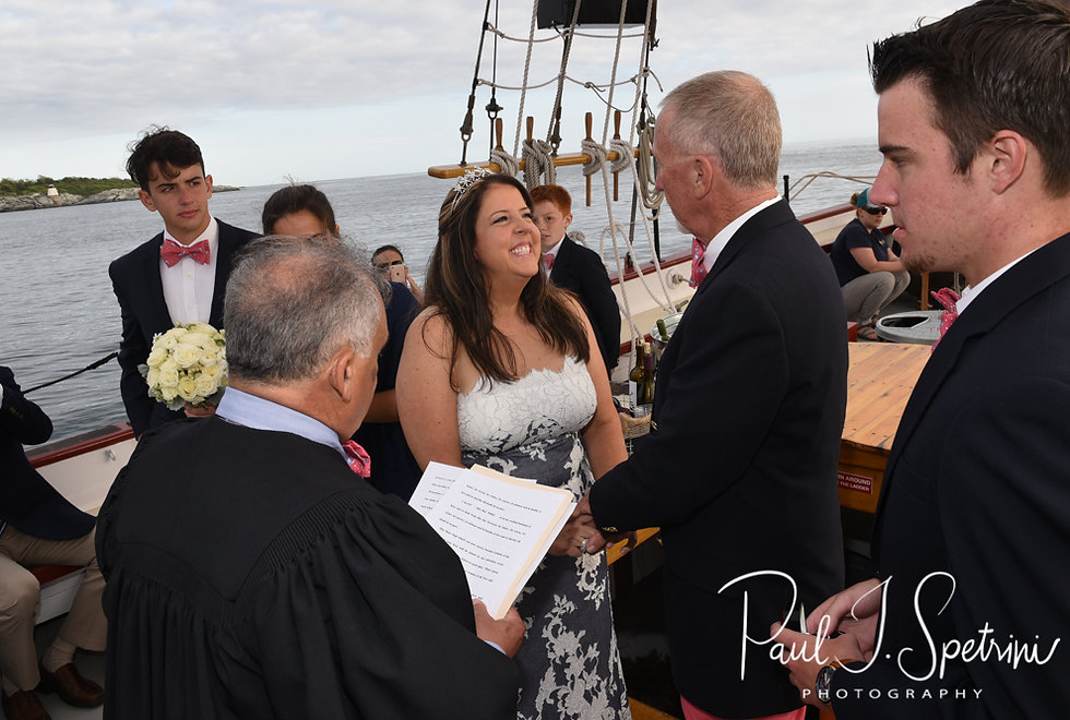 Kate smiles during her May 2018 wedding ceremony aboard the Schooner Aurora boat in the waters off Newport, Rhode Island.