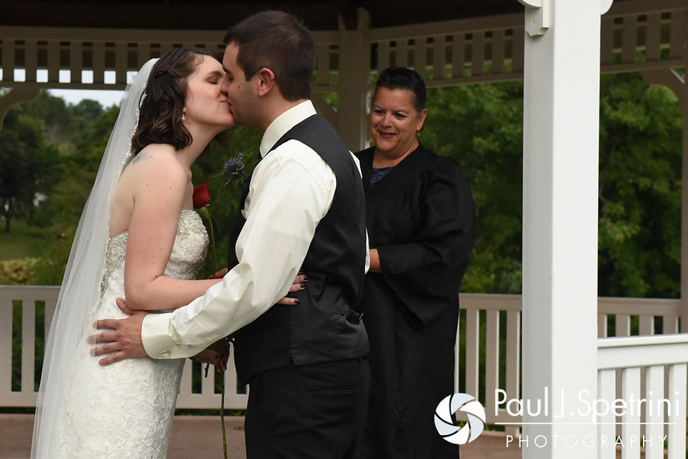 Jen and Kyle share their first kiss during their September 2016 wedding at the Roger Williams Park Botanical Center in Providence, Rhode Island.
