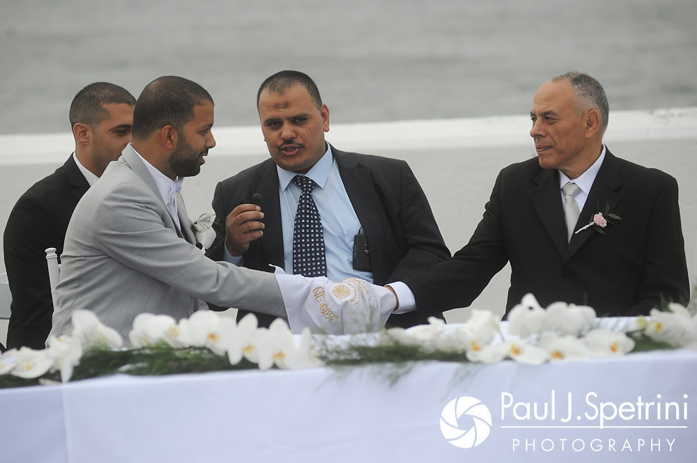 Nader shakes his father-in-law's hand during his July 2017 wedding ceremony at Belle Mer in Newport, Rhode Island.