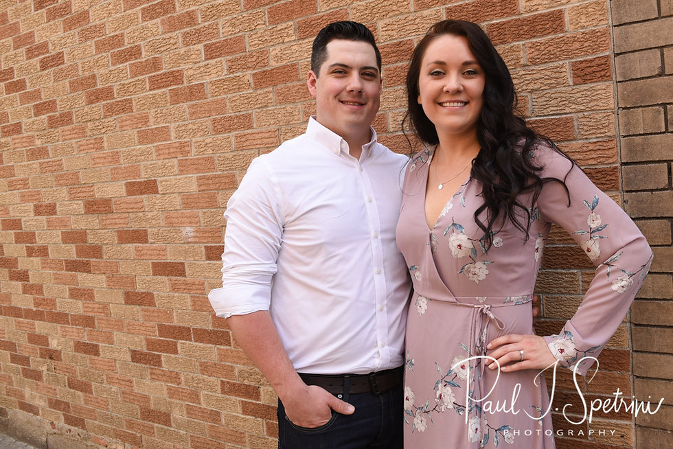 Nicole and Dan pose for a photo in the North End neighborhood of Boston, Massachusetts during their May 2018 engagement session.