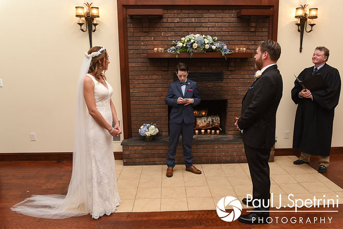 A speaker reads during Kevin and Joanna's October 2017 wedding ceremony at Cranston Country Club in Cranston, Rhode Island.