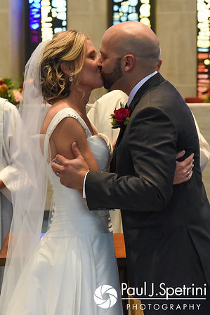 Tricia and Kevin kiss during their October 2017 wedding ceremony at St. Brendan Parish in Riverside, Rhode Island.