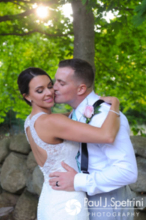 Sean and Cassie kiss during a formal photo following their July 2017 wedding ceremony at Rachel's Lakeside in Dartmouth, Massachusetts.