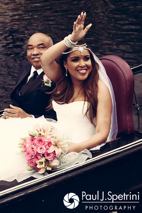 Lucelene waves at friends and family members from a gondola prior to her June 2017 wedding ceremony at Waterplace Park in Providence, Rhode Island.