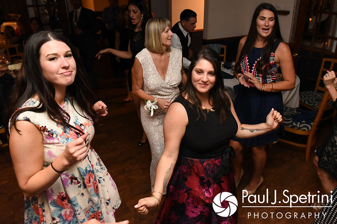 Guests dance during Jennifer and Robert's September 2017 wedding reception at Oceanside at the Pier in Narragansett, Rhode Island.