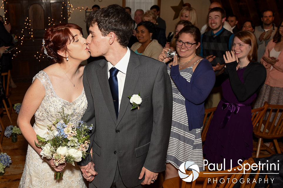 Ellen and Jeremy share a kiss following their May 2016 wedding ceremony at Bittersweet Farm in Westport, Massachusetts.