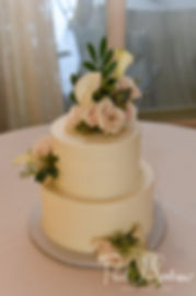 A look at the wedding cake, shown on display during Helen & Mike's September 2018 wedding reception at the Rosecliff Mansion in Newport, Rhode Island.