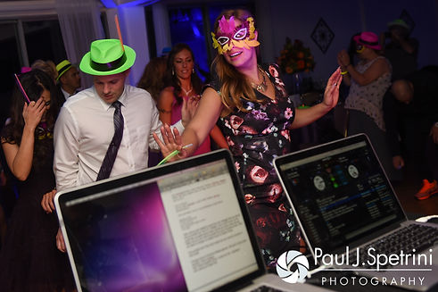 Guests dance during Stephanie and Henry's October 2016 wedding reception at Lake Pearl Luciano's in Wrentham, Massachusetts.