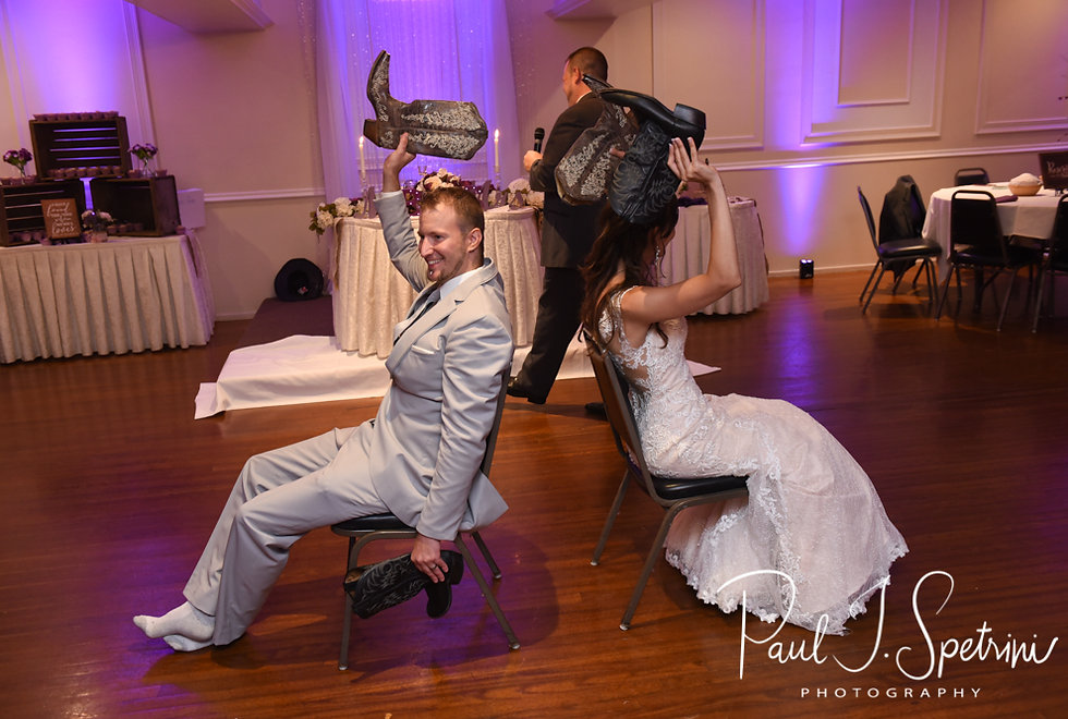 Beth & Bryan play the shoe game during their August 2018 wedding reception at McGovern's on the Water in Fall River, Massachusetts.