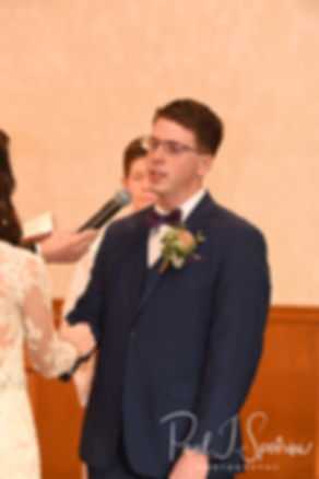 Mack looks at Stacey during his December 2018 wedding ceremony at St. Teresa's Church in Attleboro, Massachusetts.