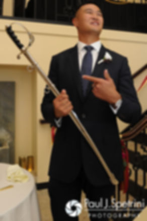 Dan pulls out a sword to cut his wedding cake during his June 2016 wedding in Providence, Rhode Island.