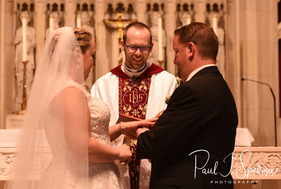Courtney and Patrick exchange rings during their September2018 wedding ceremony at St. Paul Church in Cranston, Rhode Island.