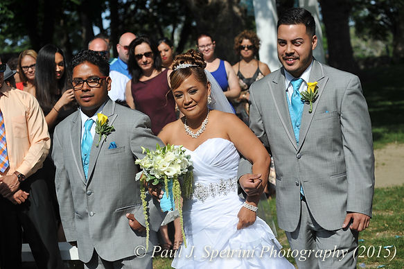 Jean Andrade comes down the aisle with her sons at her wedding.