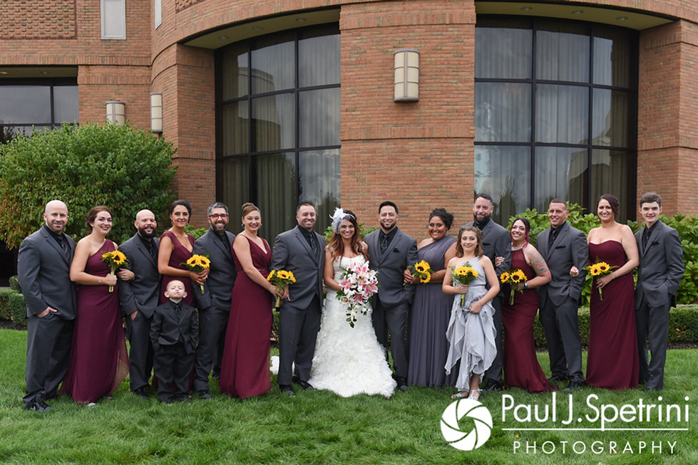 Dallas and Nicky pose for a formal photo with the members of their wedding party following their September 2017 wedding ceremony at the Crowne Plaza Hotel in Warwick, Rhode Island.