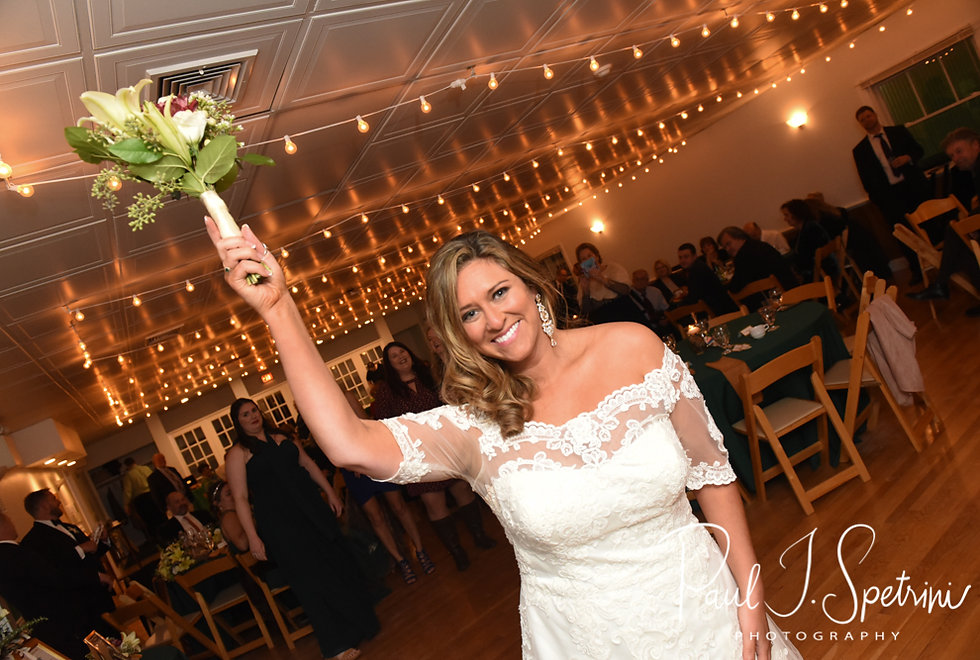 Cara gets ready to throw her bouquet during her November 2018 wedding reception at the North Beach Clubhouse in Narragansett, Rhode Island.