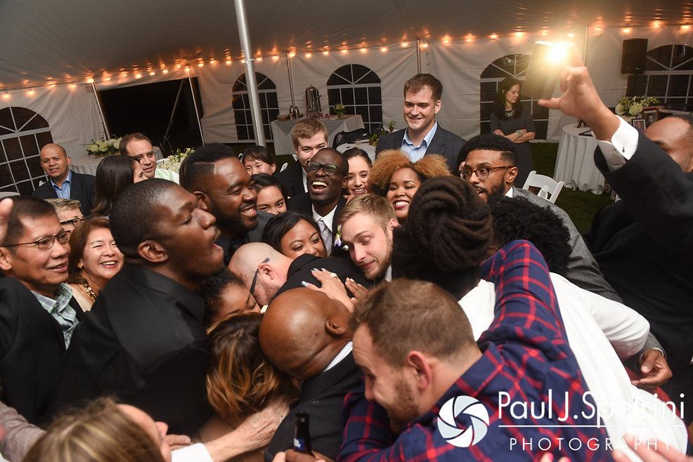 Forrester and Lisajean hug guests during their October 2016 wedding reception in Charlestown, Rhode Island.