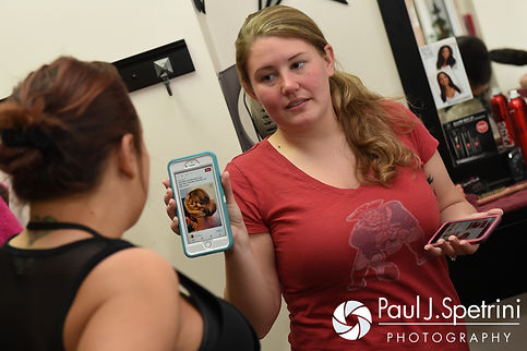 Latasha shows her hair stylist a photo from her phone prior to her May 2016 wedding at Country Gardens in Rehoboth, Massachusetts.