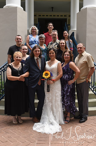 Amanda and Josh pose for a photo with family members following their October 2018 wedding ceremony at the Walt Disney World Swan & Dolphin Resort in Lake Buena Vista, Florida.