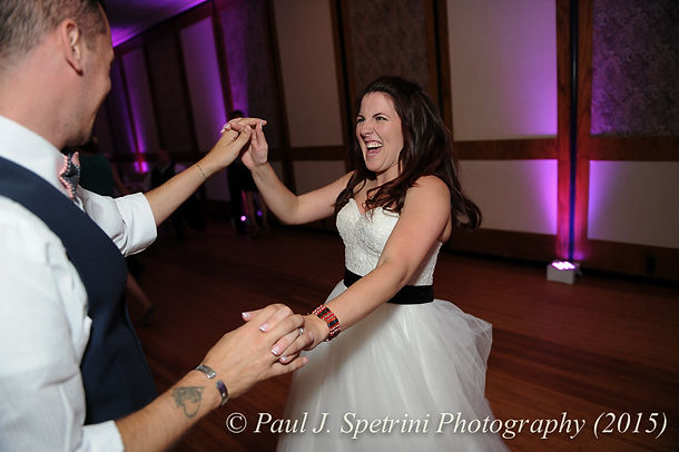 Guests dance during the wedding reception of Justin and Jamie Bolani in June 2015 in Bristol, Rhode Island.