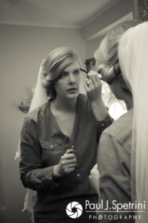 Rachel applies her eyeliner prior to her October 2017 wedding ceremony at Castle Manor Inn in Gloucester, Massachusetts.