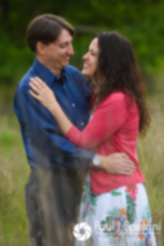 Amanda and Josh embrace at Scalloptown Park in East Greenwich, Rhode Island during their May 2017 engagement photo session.