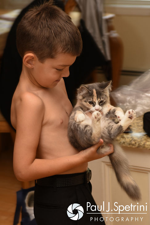 Justin and Lauryn's son plays with his kitten prior to his parents' July 2016 wedding at St. Paul the Apostle Catholic Church in Foster, Rhode Island.