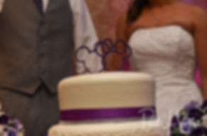 Sam and Katie prepare to cut their cake during their April 2018 wedding reception at Quidnessett Country Club in North Kingstown, Rhode Island.